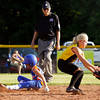 Silver Creek's Lindsay Evans slides safely into second base past Clarksville's Elizabeth Kritzer during their game at Grant Line Elementary School in New Albany on Tuesday. Clarksville won the game after eight innings, 11-7. Staff photo by Christopher Fryer