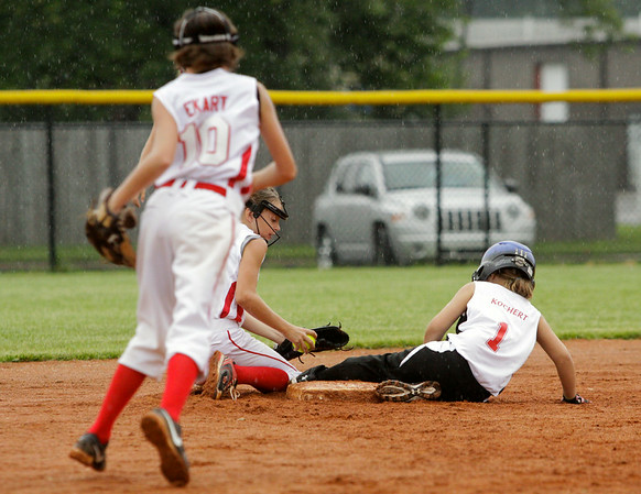 New Albany's Skylar Roark slides safely into second base during their 15-3 loss to Jeff/GRC in the semifinal round of the Little League 9-10-year-old softball state finals in Clarksville on Tuesday. Staff photo by Christopher Fryer
