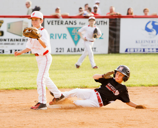 New Albany's Luke Vick slides safely into second base during their game against Jeff/GRC in the 9-10-year-old District 5 championship in New Albany on Saturday. New Albany won the game, 3-0. Staff photo by Christopher Fryer