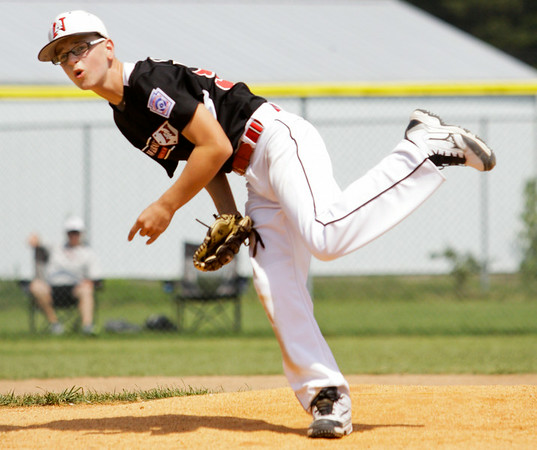 New Albany's John Castleman pitches during the third inning of their game against Terre Haute North in the Minor Baseball State Tournament at John and Shirley Woehrle Field in Jeffersonville on Saturday. New Albany won the game, 12-3. Staff photo by Christopher Fryer