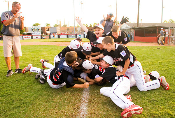 New Albany celebrates after their 3-0 win over Jeff/GRC in the 9-10-year-old  District 5 championship game in New Albany on Saturday. Staff photo by Christopher Fryer