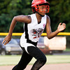 New Albany's Ariahna McNeary makes her way to home plate during the sixth inning of their game against Silver Creek in the District 5, 11-12-year-old softball championship game at Grant Line Elementary School on Tuesday. McNeary scored on the play. New Albany won the game, 5-2. Staff photo by Christopher Fryer