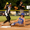 Silver Creek's Courtney Redford is forced out at third base by New Albany's Erin Bell during the second inning of the District 5, 11-12-year-old softball championship game at Grant Line Elementary School on Tuesday. New Albany won the game, 5-2. Staff photo by Christopher Fryer