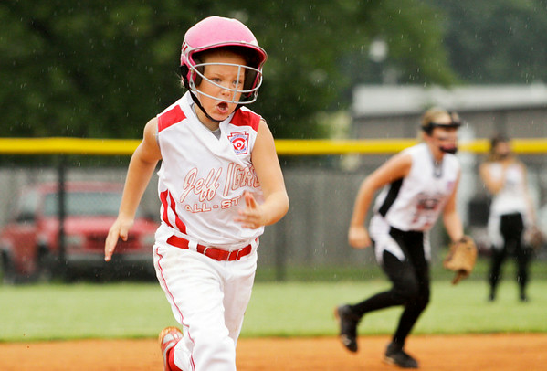 Jeff/GRC's Savannah Gaither makes her way to third base during their 15-3 victory over New Albany in the semifinal round of the Little League 9-10-year-old softball state finals in Clarksville on Tuesday. Staff photo by Christopher Fryer