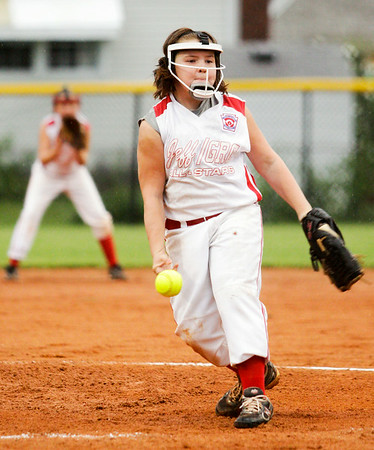Jeff/GRC's Mollie Davis pitches during their game against Fort Wayne Don Ayres in the championship round of the Little League 9-10-year-old softball state finals in Clarksville on Tuesday. Staff photo by Christopher Fryer