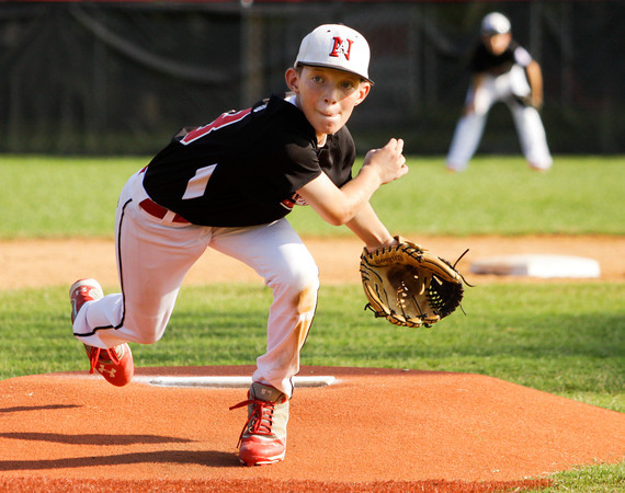 New Albany's Newbanks pitches during their game against HYR at Mt. Tabor on Thursday. New Albany won the game in four innings, 17-2. Staff photo by Christopher Fryer