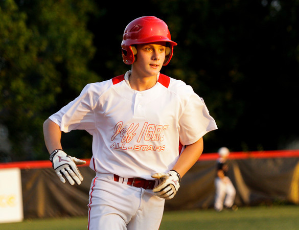 Jeff/GRC's Drew Taylor rounds the bases after hitting a two-run-homer during their game against New Albany in the 11-12-year-old District 5 championship game at Mt.Tabor Park in New Albany on Tuesday. Jeff/GRC won the game, 12-3. Staff photo by Christopher Fryer