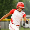 Jeff/GRC's Nangely Garcia Davila heads to third on a two-run RBI triple during their 15-3 victory over New Albany in the semifinal round of the Little League 9-10-year-old softball state finals in Clarksville on Tuesday. Staff photo by Christopher Fryer