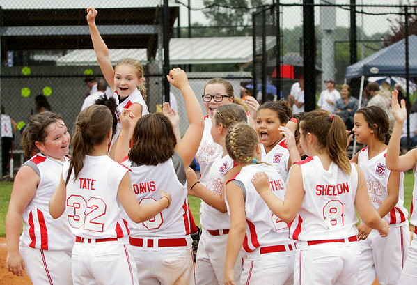 Jeff/GRC celebrates on the pitchers mound after their 15-3 victory over New Albany during the semifinal round of the Little League 9-10-year-old softball state finals in Clarksville on Tuesday. Staff photo by Christopher Fryer