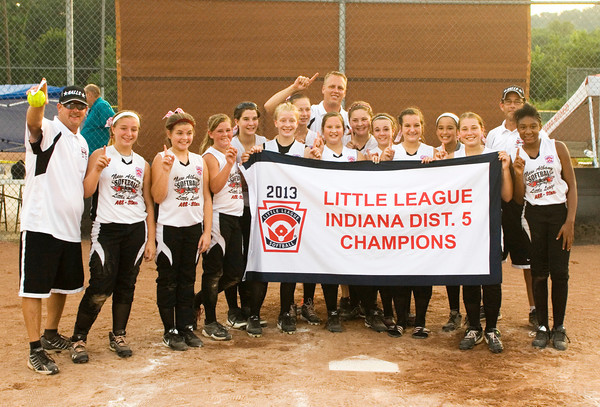 New Albany poses with their championship banner after their 5-2 victory over Silver Creek in the District 5, 11-12-year-old softball championship game at Grant Line Elementary School on Tuesday. Staff photo by Christopher Fryer