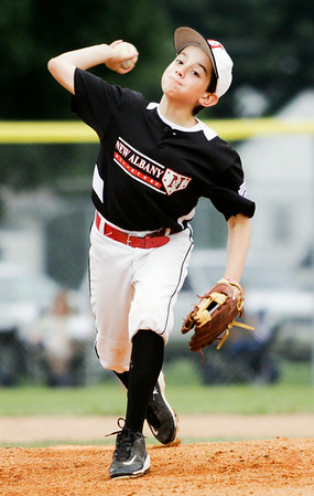 New Albany's Hunter Sprigler pitches during their 10-0 win over Auburn in the semifinal round of the 9-10-year-old Little League Baseball state tournament in Jeffersonville on Tuesday. Staff photo by Christopher Fryer