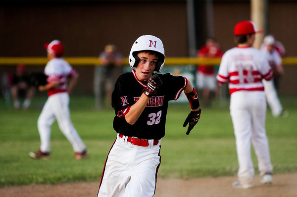 Max Beatty approaches third base on his way to score off of a Tucker Biven triple during New Albany's game against Jeff/GRC at the 11-12-year-old District 5 tournament in Sellersburg on Monday. Staff photo by Christopher Fryer