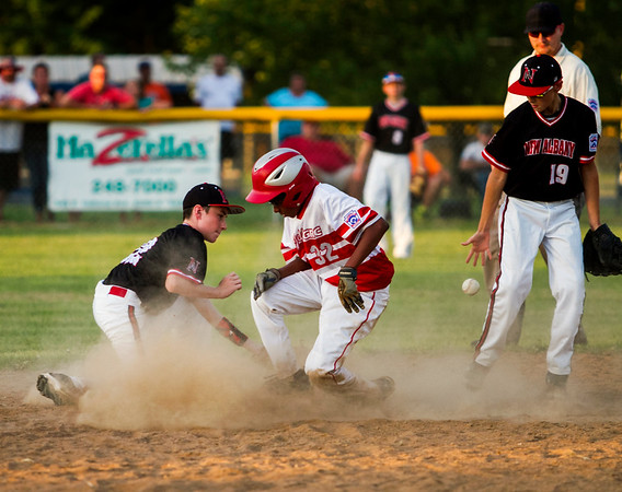 Xavier Hart slides safely into second base during Jeff/GRC's game against New Albany at the 11-12-year-old District 5 tournament in Sellersburg on Monday. Staff photo by Christopher Fryer