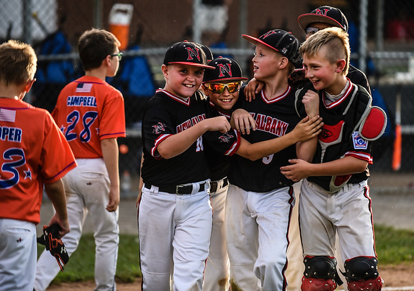 New Albany teammates celebrate their 8-5 win over Silver Creek for the District 5 Little League Minor Championship on Saturday in Sellersburg. Staff photo by Tyler Stewart