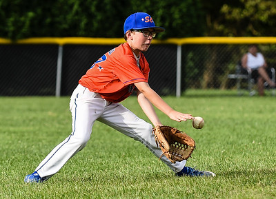 Silver Creek shortstop Noah Campbell fields a ground ball during New Albany's 8-5 win for the District 5 Little League Minor Championship on Saturday in Sellersburg. Staff photo by Tyler Stewart