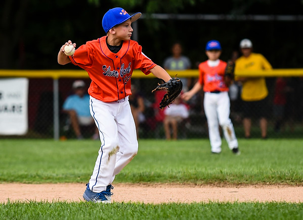 Silver Creek second baseman Brennan Cooper makes the throw to first after fielding a ground ball during New Albany's 8-5 win for the District 5 Little League Minor Championship on Saturday in Sellersburg. Staff photo by Tyler Stewart