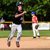 Cody Jackson runs to third base during New Albany's 8-5 win over Silver Creek for the District 5 Little League Minor Championship on Saturday in Sellersburg. Staff photo by Tyler Stewart