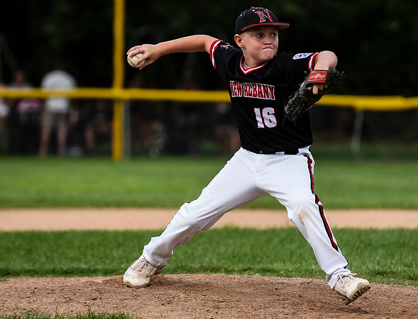 New Albany pitcher Landon Gum throws to the Silver Creek batter during New Albany's 8-5 win for the District 5 Little League Minor Championship on Saturday in Sellersburg. Staff photo by Tyler Stewart