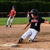 New Albany third baseman Chase Loesch slides into third base during New Albany's 8-5 win over Silver Creek for the District 5 Little League Minor Championship on Saturday in Sellersburg. Staff photo by Tyler Stewart