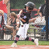 New Albany All-Star Caleb Goldman makes contact with a pitch at the plate during New Albany's 11-0 victory over Greater Clark in the District 5 eleven year old championship game at Kevin Hammersmith Memorial Park on Friday.  Photo by Joe Ullrich
