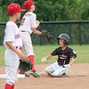 New Albany All-Star Cash Anderson slide into second base during New Albany's 11-0 victory over Greater Clark in the District 5 eleven year old championship game at Kevin Hammersmith Memorial Park on Friday.  Photo by Joe Ullrich
