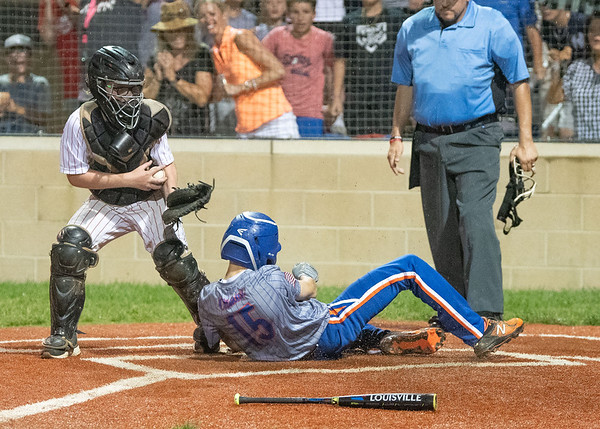 Silver Creek All-Star Drake Oltman slides into home plate after belting a in-the-park home run during their 9-4 victory over Jeff/GRC in the District 5 twelve year-old championship game at Kevin Hammersmith Memorial Park on Monday.  Photo by Joe Ullrich