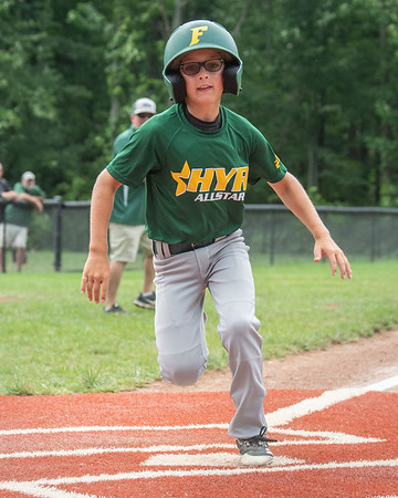 Highlander Youth Recreation All-Star Easton Loetus scores HYR's 7-2 victory over Greater Clark in the District 5 ten year-old championship game at Kevin Hammersmith Memorial Park on Monday.  Photo by Joe Ullrich