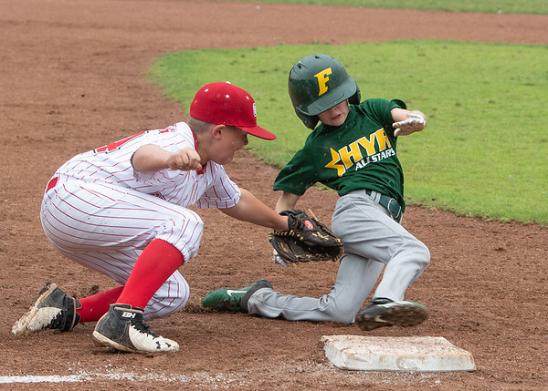 Jeff/GRC All-Star Elijah Isenburg makes a play at third base during Jeffersonville's 7-2 loss to Highlander Youth Recreation in the District 5 ten year-old championship game at Kevin Hammersmith Memorial Park on Monday.  Photo by Joe Ullrich