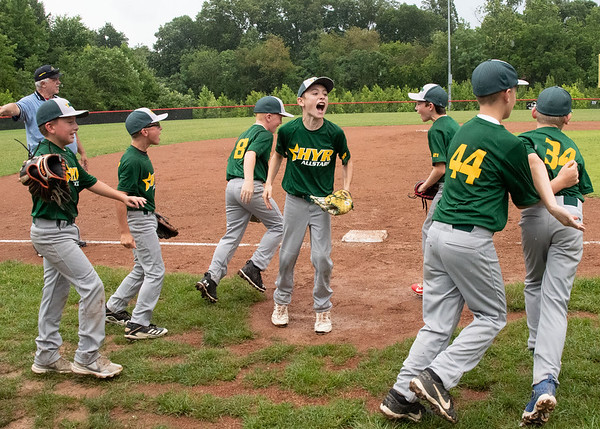 Highlander Youth Recreation celebrates after their 7-2 victory over Greater Clark in the District 5 ten year-old championship game at Kevin Hammersmith Memorial Park on Monday.  Photo by Joe Ullrich