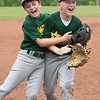 Highlander Youth RecreationAll-Star's celebrate after their 7-2 victory over Greater Clark in the District 5 ten year-old championship game at Kevin Hammersmith Memorial Park on Monday.  Photo by Joe Ullrich