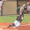 New Albany All-Star Keaton Hamilton slides into home plate for a score during New Albany's 11-0 victory over Greater Clark in the District 5 eleven year old championship game at Kevin Hammersmith Memorial Park on Friday.  Photo by Joe Ullrich