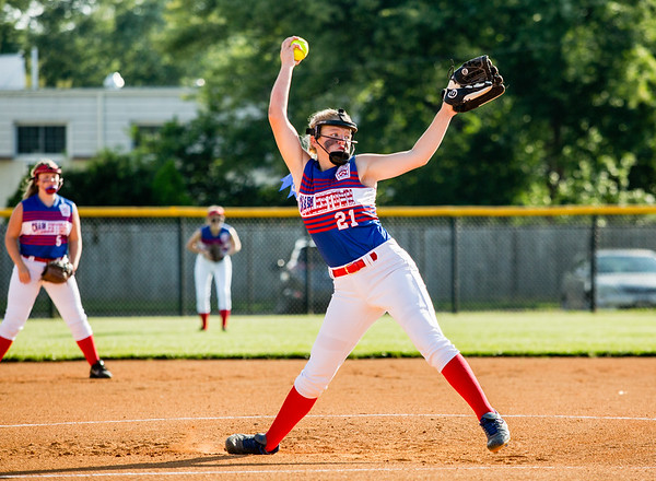 Charlestown's Savannah Gather winds up a pitch during their Junior Softball State Tournament win against DeMotte at Clarksville Little League fields on Friday. Staff Photos By Josh Hicks