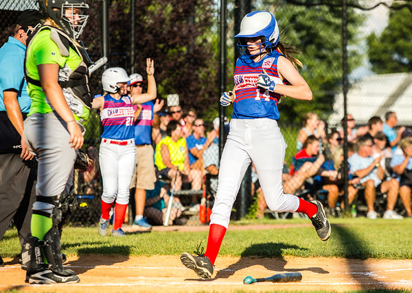 Charlestown's Sadee Goedeker plants her foot on home plate during their Junior Softball State Tournament win against DeMotte at Clarksville Little League fields on Friday.