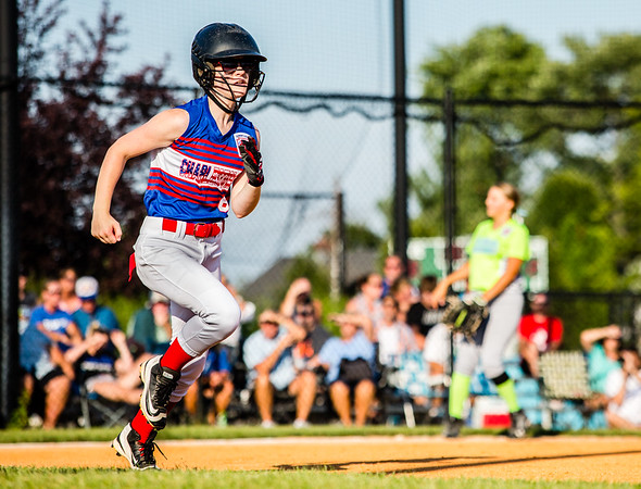 Charlestown's Andrea Huntsinger makes a run for first base during their Junior Softball State Tournament win against DeMotte at Clarksville Little League fields on Friday.