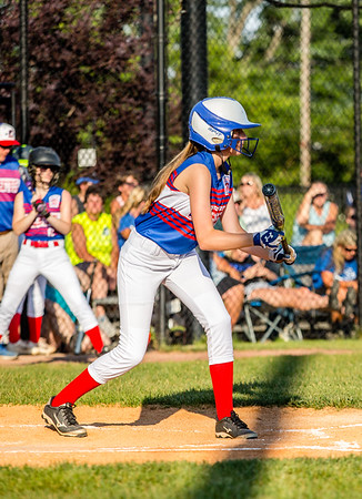 Charlestown's Sadee Goedeker waves her bat before, preparing for a bunt during their Junior Softball State Tournament win against DeMotte at Clarksville Little League fields on Friday.
