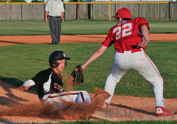 New Albany All-Star Jonah Boone slides into third base during Wednesday's  District 5, 13/14 division championship game against Jeff/GRC. Photo by Joe Ullrich