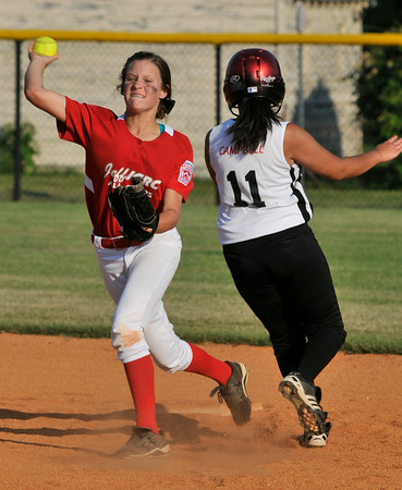 Jeff/GRC All-Star Meghan Lay attempts a double play during Wednesday's 19-0 victory over New Albany to capture the District 5 Junior Softball Championship title. Photo by Joe Ullrich