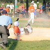 New Albany pitcher Hayden Krebs misses the tag on Silver Creek's Landon Kruer at home plate during the New Albany and Silver Creek 11-12 baseball pool play game in the District 5 All-Star tournament at the Clarksville Little League Park Friday. <br /> Staff photo by Tyler Stewart