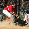 New Albany's Taylor Watt slides to beat the Jeff/GRC tag by Nan Garcia at third base during New Albany and Jeff/GRC's 11 and 12-year-old All-Star game at the Clarksville Little League Park Tuesday.<br /> Staff photo by Tyler Stewart