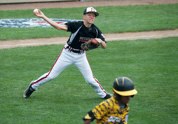 New Albany's Cooper Biven fields a short grounder for the out at first during New Albany's 12-7 loss to Chicago's Jackie Robinson West in the Great Lakes Region Championship in Indianapolis Saturday.<br /> Staff photo by Tyler Stewart