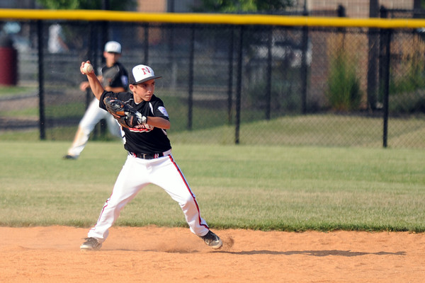New Albany second baseman Andrew Ricketts fields a grounder during the New Albany and Silver Creek 11-12 baseball pool play game in the District 5 All-Star tournament at the Clarksville Little League Park Friday. <br /> Staff photo by Tyler Stewart