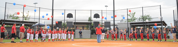 Players release balloons prior to Friday's  9/10 Indiana State softball tournament game between Jeff/GRC and Bedford. Photo by Joe Ullrich