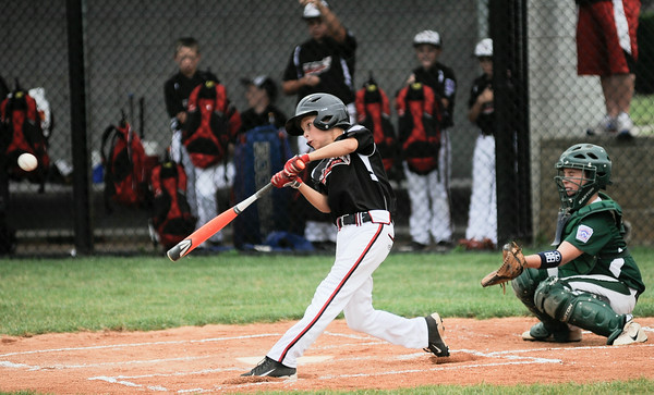 New Albany All-Star Caleb Doss gets a two run double during Monday's District 5, 10/11 year old, pool game against Highlander Youth Recreation. Photo by Joe Ullrich