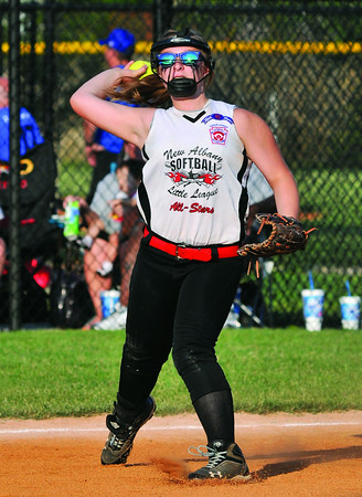 New Albany All-Star Kelsey Adams throws to first base during Wednesday's 19-0 loss to Jeff/GRC in the District 5 Junior Softball Championship game. Photo by Joe Ullrich