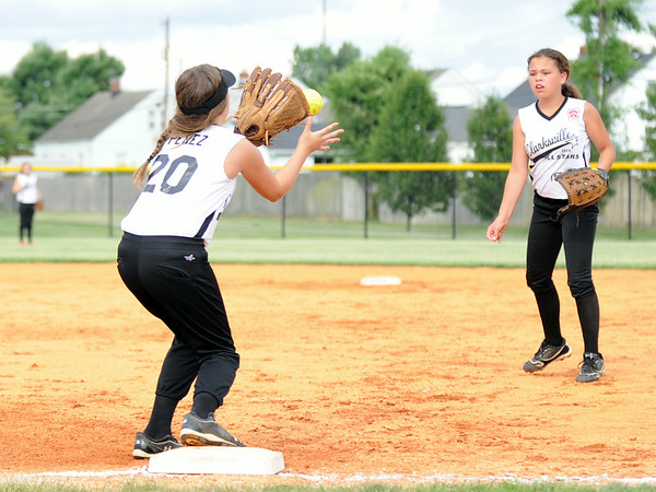 Clarksville second baseman Angel Long makes the throw to Kylie Perez at first after fielding a ground ball during the Clarksville and Jeff/GRC 11-12 softball pool play game in the District 5 All-Star tournament at Clarksville Little League Park Thursday. Jeff/GRC won 10-0.<br /> Staff photo by Tyler Stewart