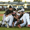 New Albany teammates pile on top on another in celebration after the New Albany and HYR 9-10 District 5 All-Star Championship at the Clarksville Little League Park Wednesday evening. New Albany won 5-1.<br /> Staff photo by Tyler Stewart