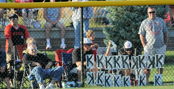New Albany All-Star fans keep count of the strike outs behind the center field fence during Tuesday's District 5, Major division championship game against Jeff/GRC. Photo by Joe Ullrich