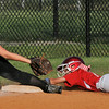 Jeff/GRC All-Star Juliette Schuur slides into third base during Wednesday's District 5 Junior Softball Championship game against New Albany. Photo by Joe Ullrich