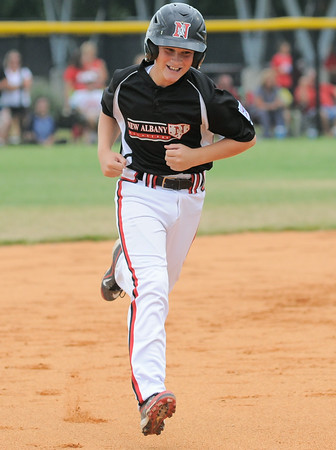 New Albany All-Star Cody Medley runs the bases after hitting a solo home run during Monday's postponed 11/12 year old championship game. Photo by Joe Ullrich