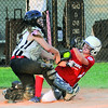 New Albany All-Star Dallas Henderson tags out Jeff/GRC All-Star Faith Denig at the plate during Wednesday's 19-0 loss in the District 5 Junior Softball Championship game. Photo by Joe Ullrich